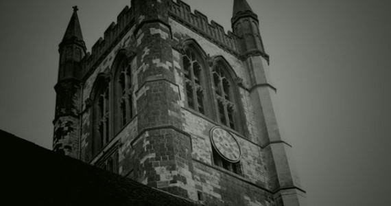 The largest parish church in Surrey, is haunted by and old lady dressed in white.