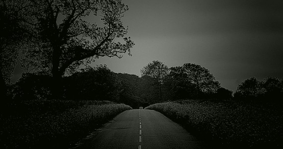 The A38 Willand to Taunton Road is the haunt of a bedraggled figure, who wears a long grey overcoat.